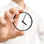 Luxury realtor holding image of time/clock.