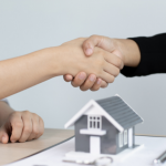 Realtor and seller shaking hands after an opportunity.